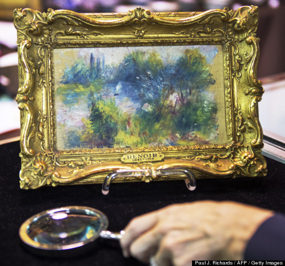 Renoir painting and magnifying glass