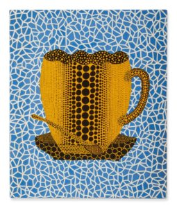 yellow coffee cup on blue background