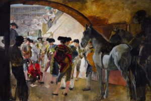 men and horses standing in a tunnel