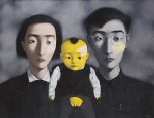 mother and father with baby with yellow face