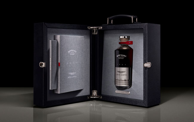 Bottle of Black Bowmore whiskey in presentation case with Aston Martin DB5 piston on bottle