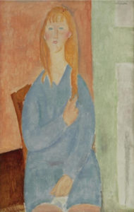 seated woman in a light blue dress