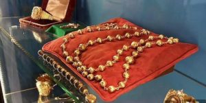 rosary beads on a red pillow
