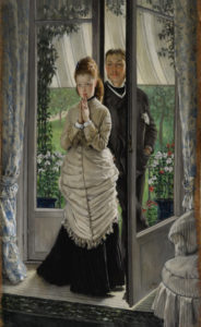 a man and woman in a doorway