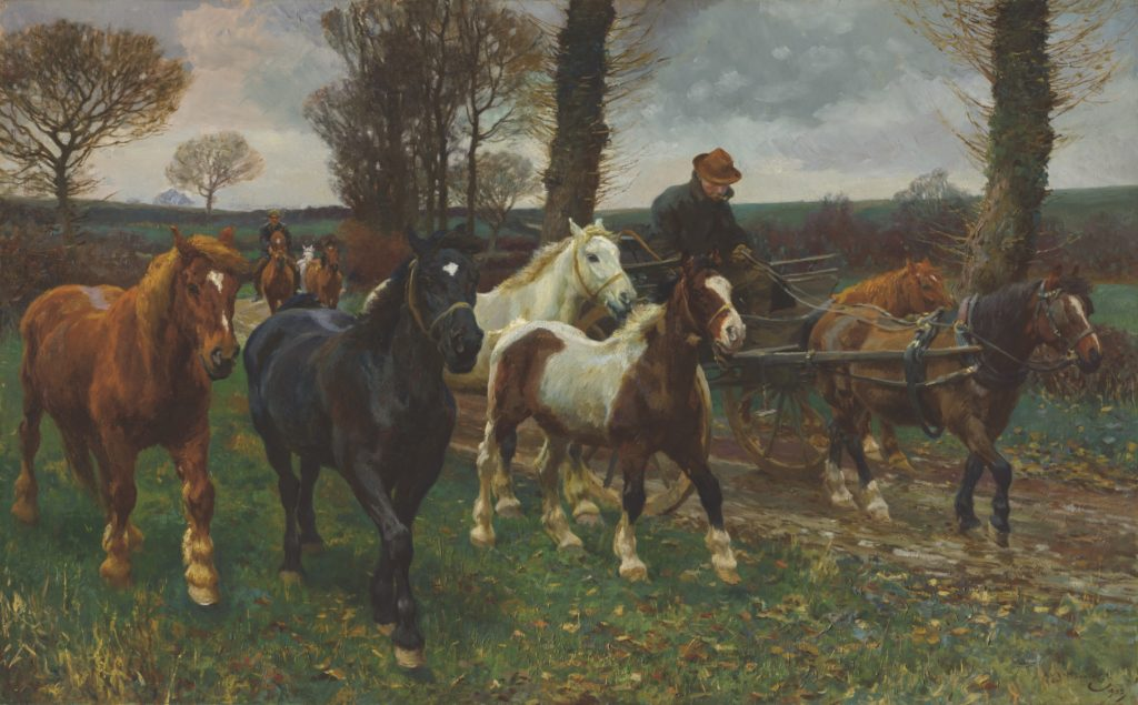 horses running through a ladnscape