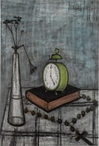 flowers, clock, and cross on a table