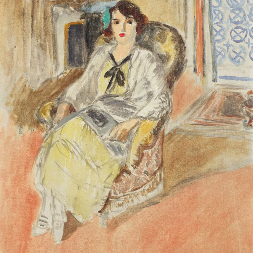 woman seated in a chair