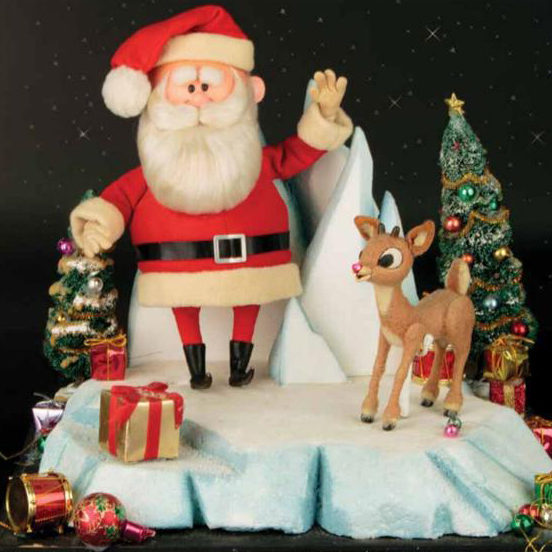 Santa Claus and Rudolph the red nosed reindeer standing on snow with presents